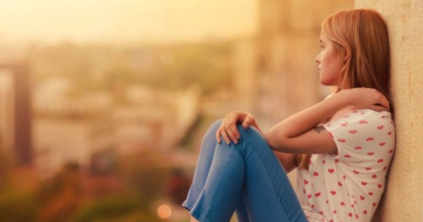Girl sitting on Roof