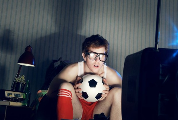 Young guy watching sport